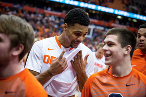 Syracuse walk-on guard Mike Sutton, right, played 12 minutes over seven games this season.